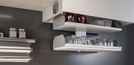 A lift provides convenient access to the contents of the wall unit